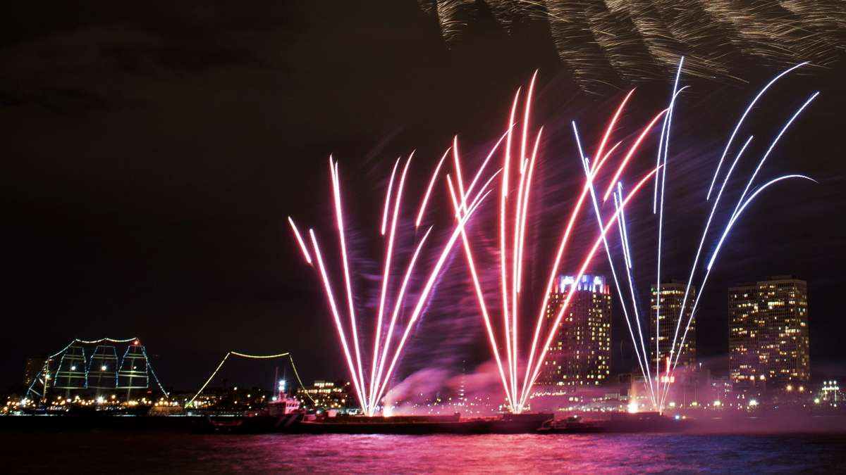 A view of the 6 p.m. display of the New Year's fireworks as seen from the Camden Waterfront with Penn's Landing and Society Hill in the background.