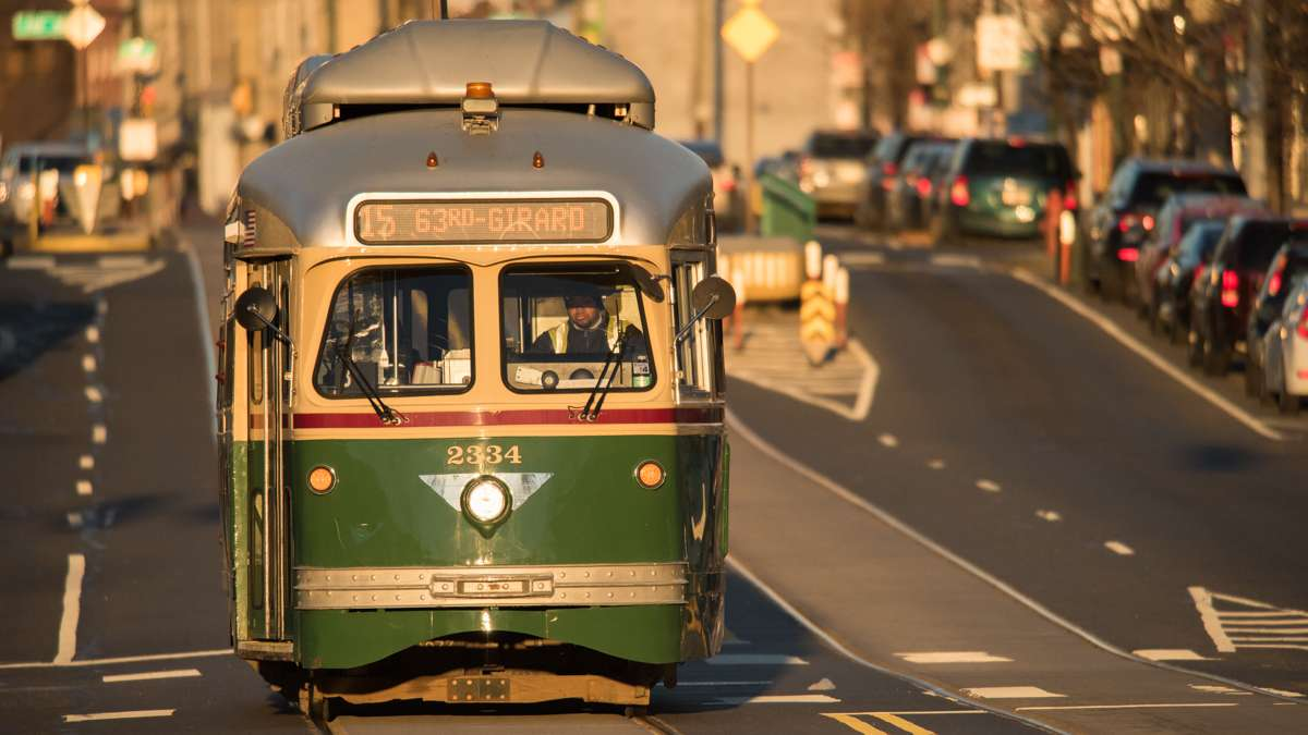 The Girard Avenue trolley gleams green and yellow in the light of the newly risen sun.