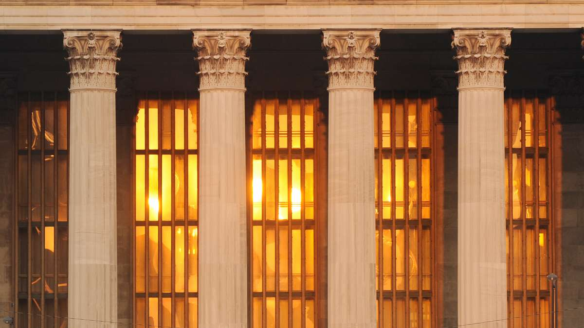 The rising sun is reflected in the windows behind the Corinthian columns of the Philadelphia Museum of Art.