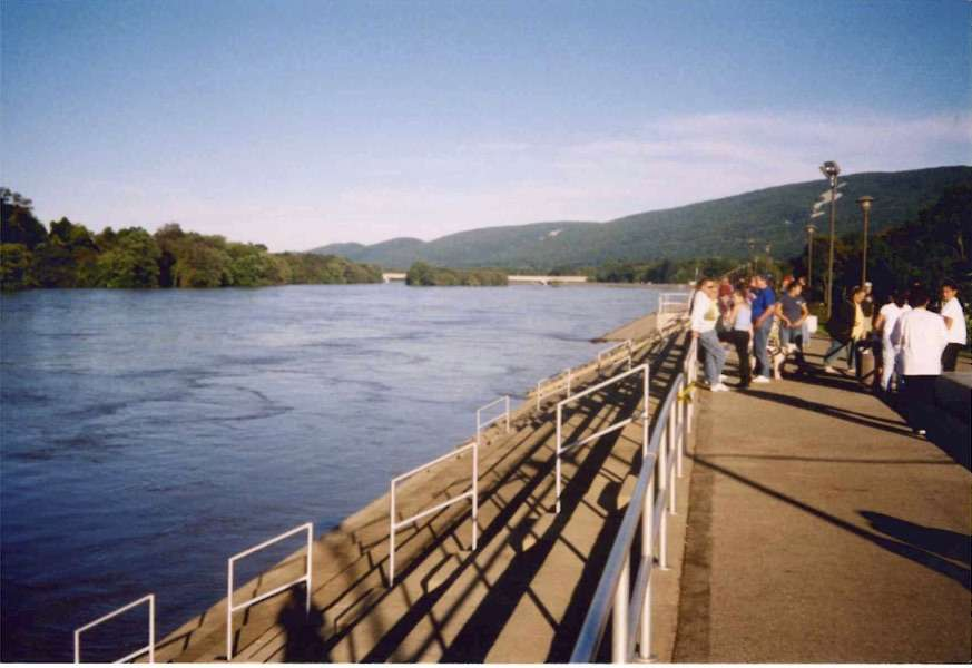 This photo from 2004 shows how high the flood waters got after Hurricane Ivan. Lock Haven sits at the lower end of the watershed, so they don't usually see the floods until a few days after the rain. Here, it's a beautiful day, except for the flooded river behind the levee. (Rich Marcinkevage, City of Lock Haven