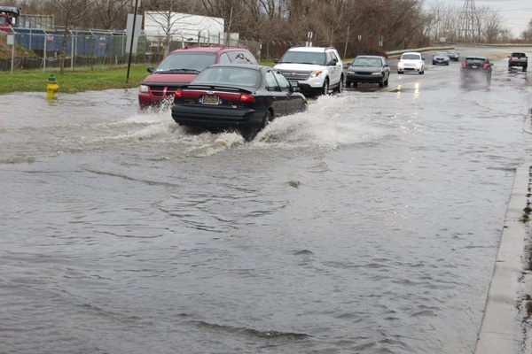<p><p>Most cars tried to squeeze as close as possible to the center of the road where the water was shallowest. (Mark Eichmann/WHYY)</p></p>