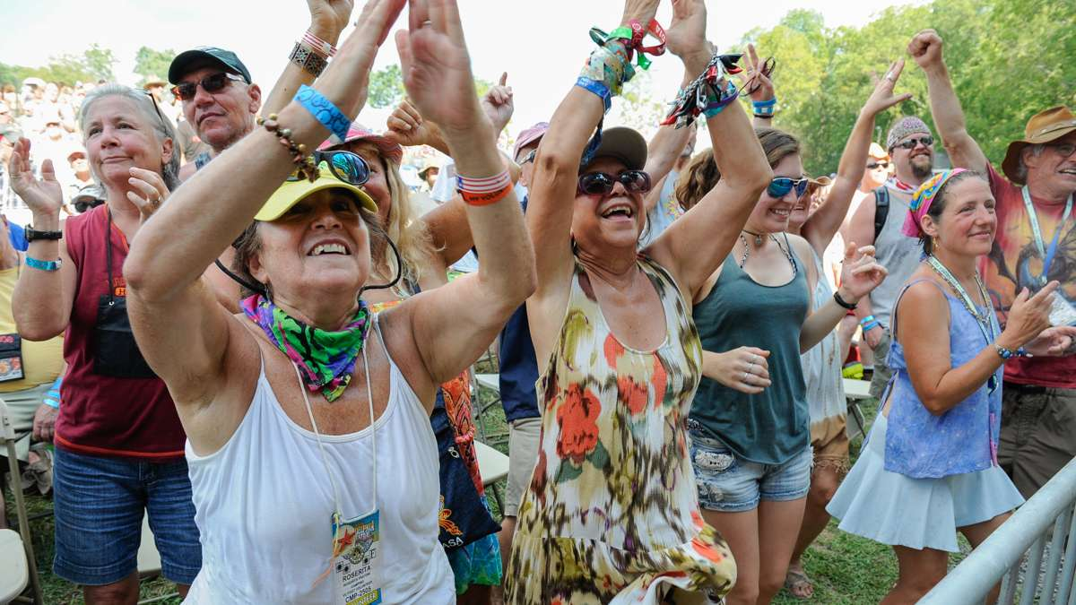 Roserita Frantoni (lef), and Nora Greenberg of Boca Raton, Florida, clap and dance to the music of Tempest.