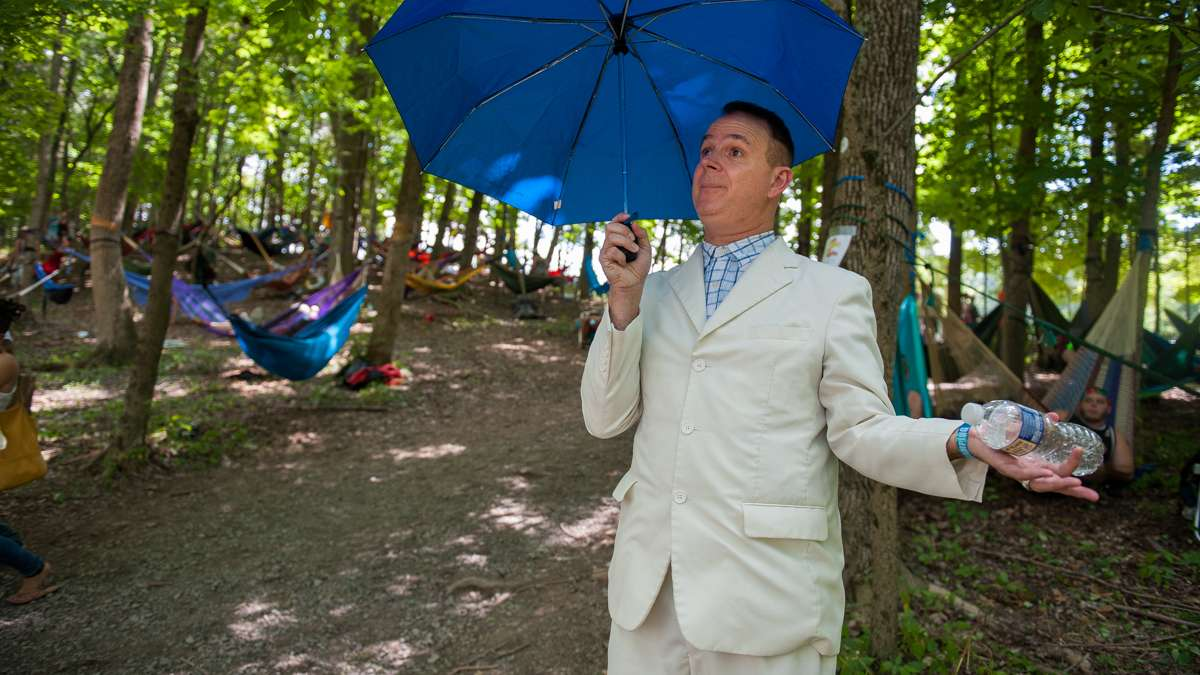 Paul Dengler, in the persona of Forrest Gump, tours the campground greeting concert goers and dispensing Gump wisdom.