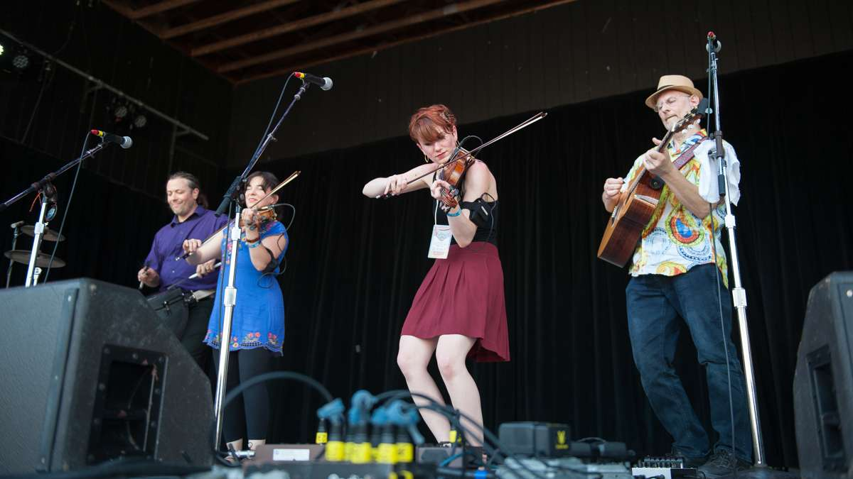 The Celtic inspired band Burning Bridget Cleary performs on the Martin Guitar Main Stage. Band members (from left) are Peter Trezzi, Amy Beshara, Rose Baldino and Lou Baldino.