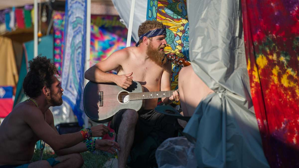 Matt Sharah (center) plays guitar with friends in the campgrounds.