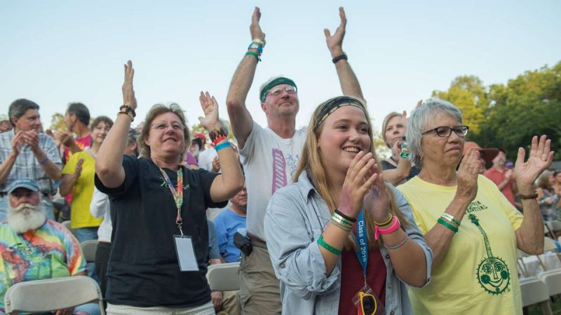 Festival-goers applaud the Irish-Latin fusion band Baile An Salsa at the conclusion of their performance. (Jonathan Wilson for NewsWorks)