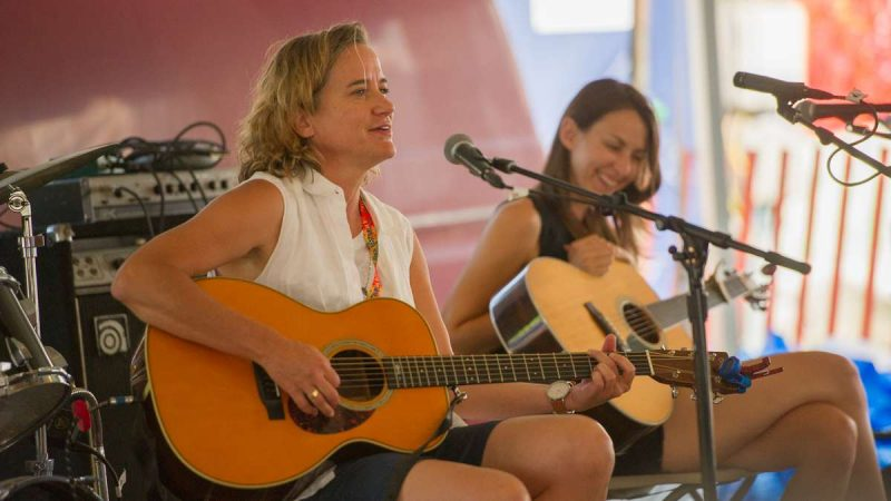 Susan Werner performs her song ''Herbicides'' in the festival's Culture Tent. (Jonathan Wilson for NewsWorks)