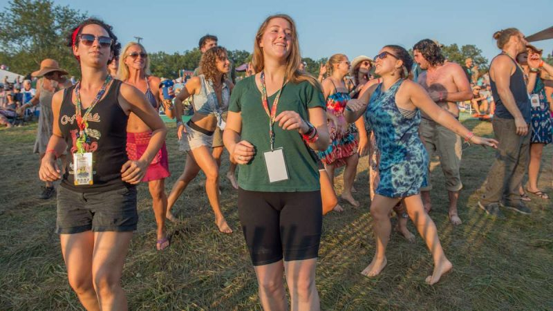 Festival-goers dance to the music of the Irish-Latin fusion band Baile An Salsa. (Jonathan Wilson for NewsWorks)
