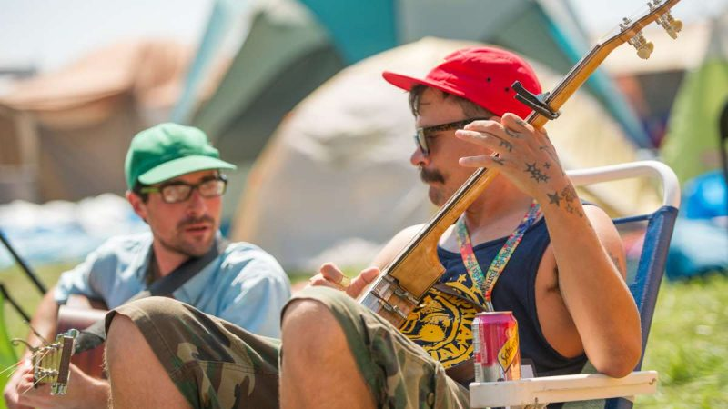 In the festival campground, Danny Mulligan (left) and Huey McBanjo play Blue Grass music. The two are members of the South Philadelphia group The White Cheddar Boys. (Jonathan Wilson for NewsWorks)