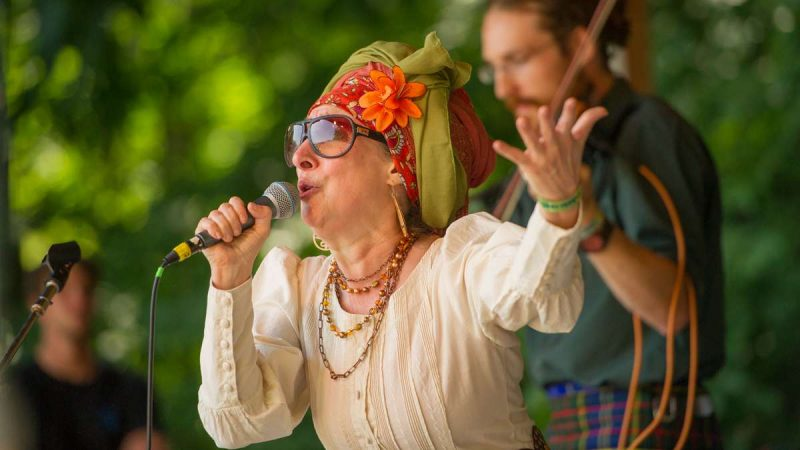 Janet Bressler, the lead singer of Sylvia Platypus, gives a Sunday afternoon performance on the Camp Stage. (Jonathan Wilson for NewsWorks)