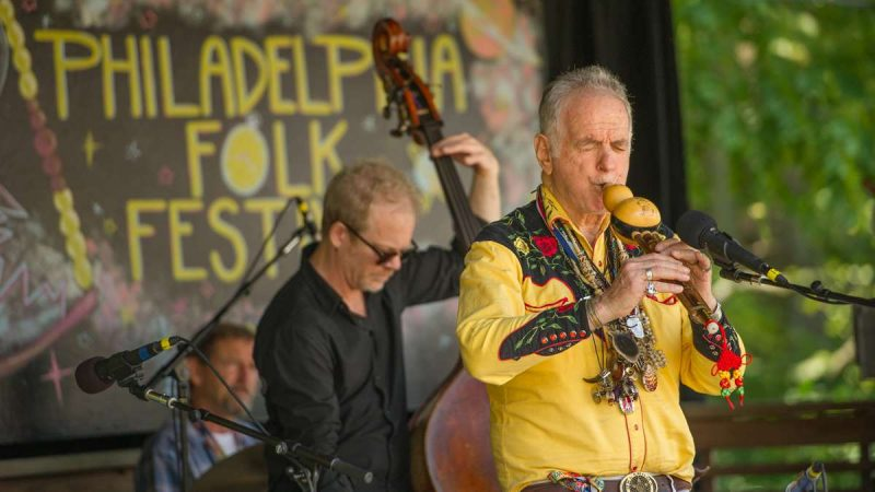 Global folk musician David Amram performs with friends on the festival's Tank Stage. (Jonathan Wilson for NewsWorks)