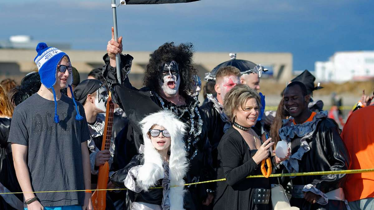Scott Rambo (middle), of the PiggyPark Plungers in his Gene Simmons outfit. (Bastiaan Slabbers/for NewsWorks)