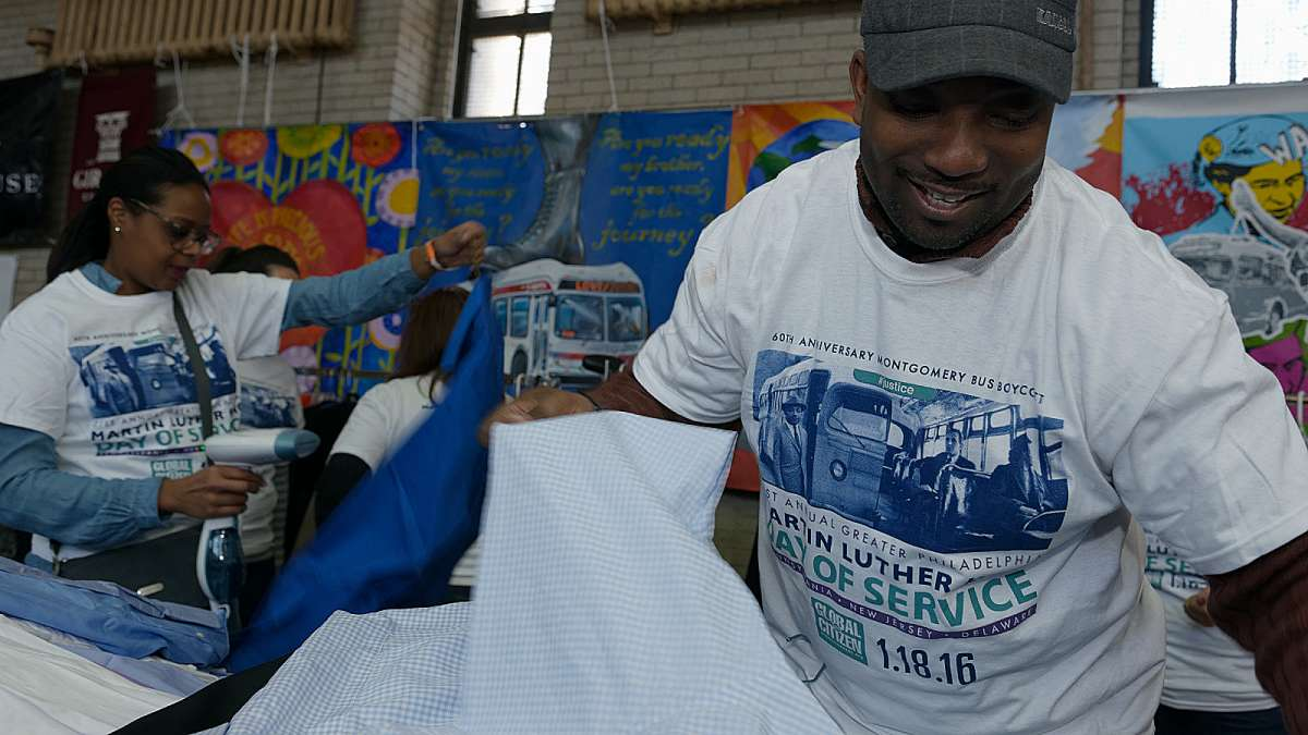 Volunteers from Comcast help sort through the donated clothes. (Bastiaan Slabbers/for NewsWorks)