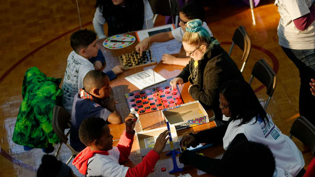 Participants in the Martin Luther King Day of Service event at Girard College play board games. (Bastiaan Slabbers/for NewsWorks)