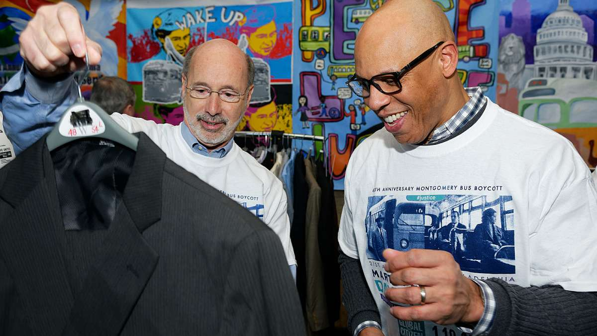 Pa. Gov. Tom Wolf (left) and Philadelphia schools Superintendent William Hite check out a donated jacket. (Bastiaan Slabbers/for NewsWorks)