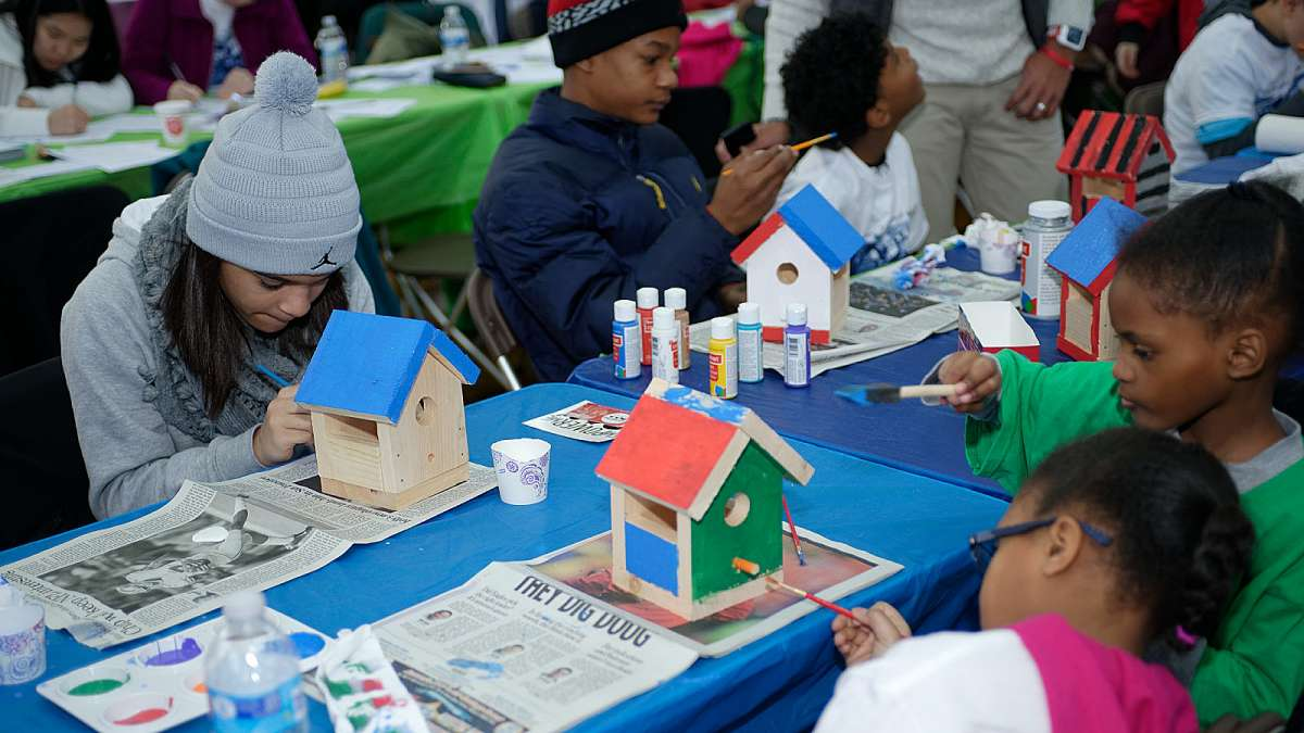 Young volunteers decorate birdhouses during the Martin Luther King Day of Service event at Girard College. (Bastiaan Slabbers/for NewsWorks)