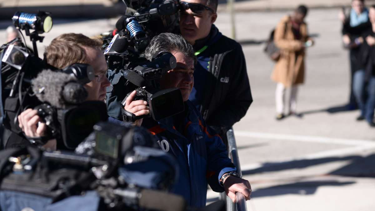Camera operators wait on the courthouse steps as Cosby's hearing recesses at lunch time.