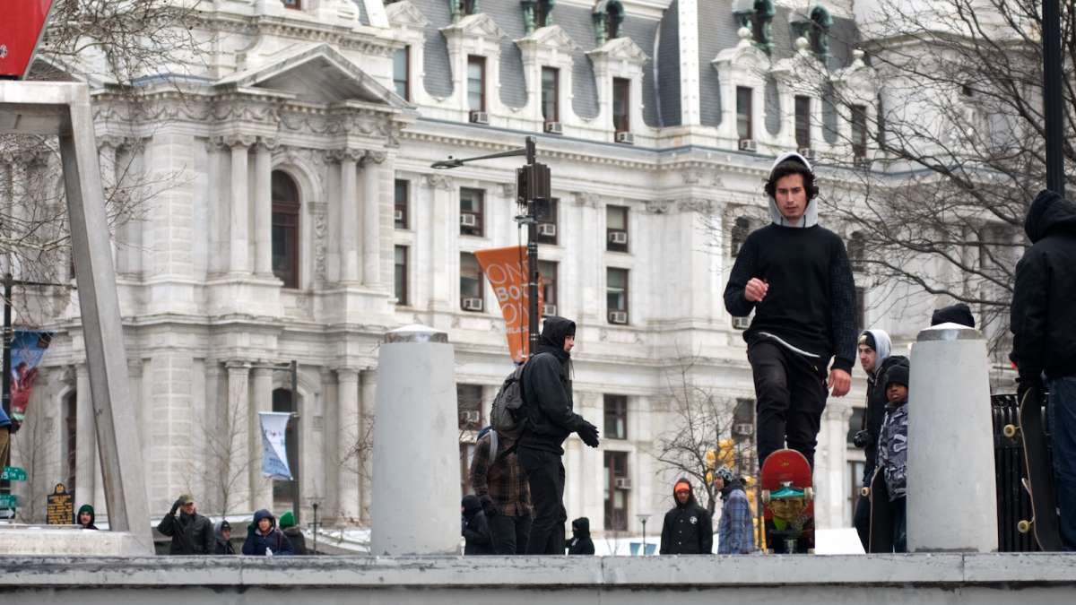 A skater is seen sizing-up the 'LOVE Park gap', as he prepares to attempt a jump into the fountain base.
