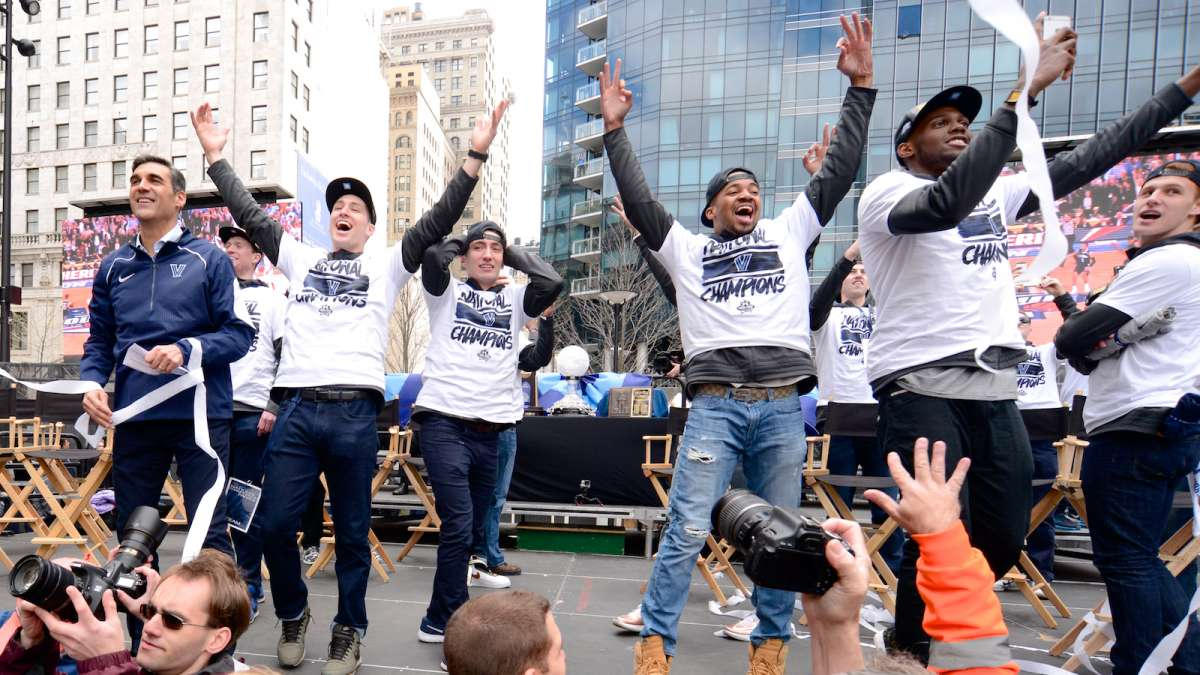 The Wildcats celebrate at Dilworth Plaza.