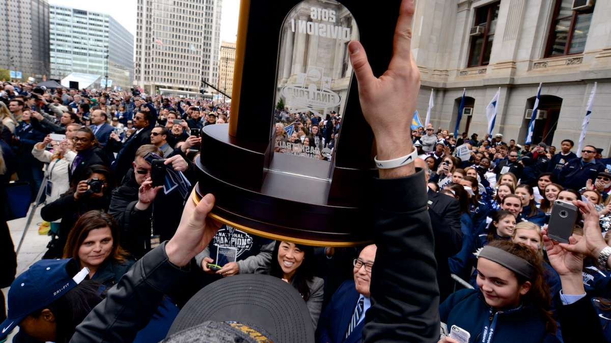 Ryan Arcidiacono presents the NCAA Championship trophy to a crowd at Dilworth Plaza on Friday.