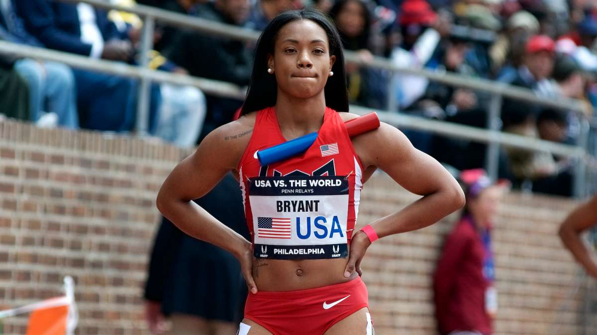 Dezerea Bryant with Team USA Blue prepare for the U.S.A. vs. the World 4x100 event. The race is won by the USA Red team.