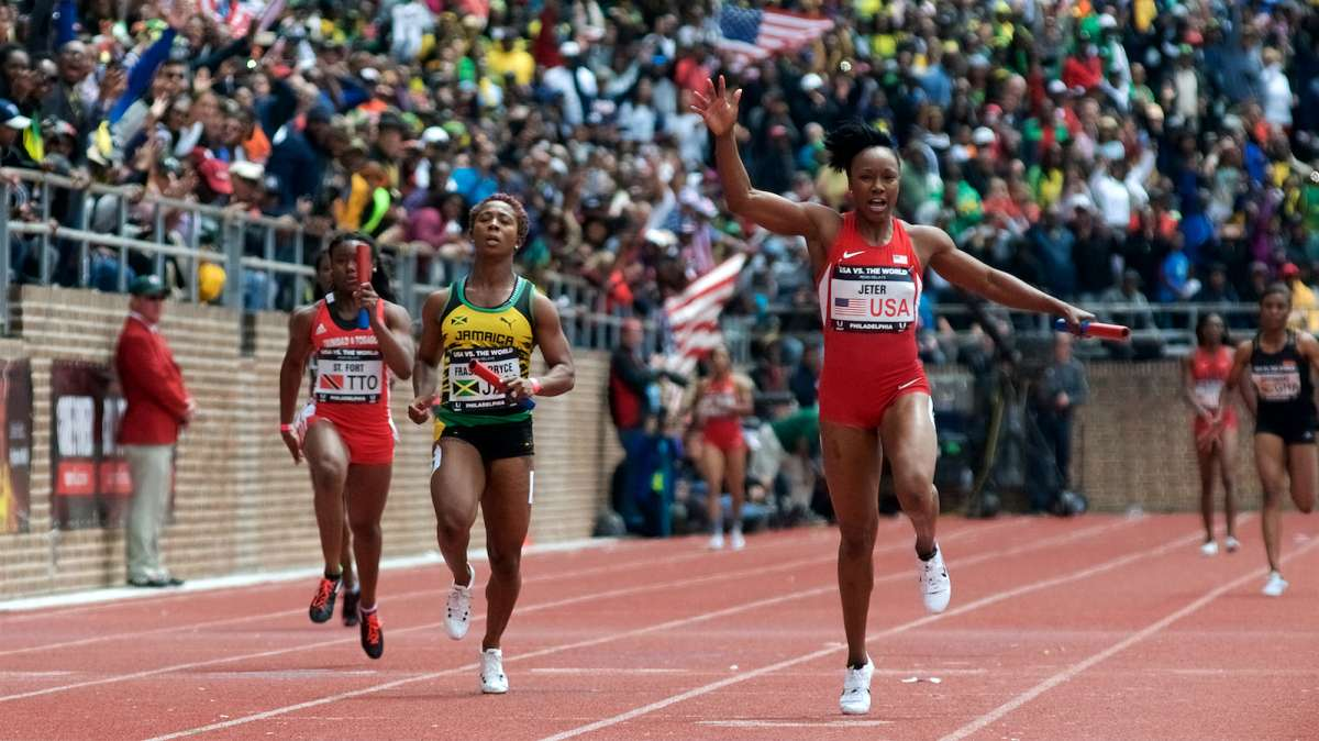 Carmelita Jeter comes over the finish line in the U.S.A. vs. the World 4x100m event.