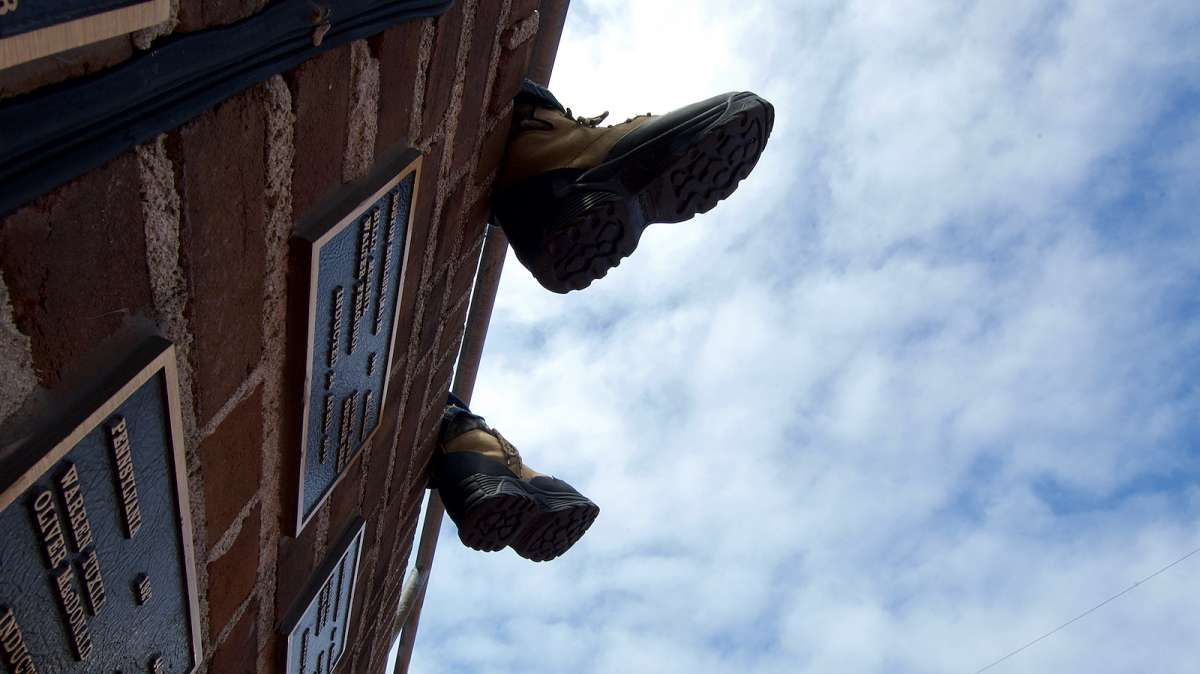 Feet, belonging to one of the thousands of spectators, dangle over the Wall of Fame on the far end of Franklin Field.
