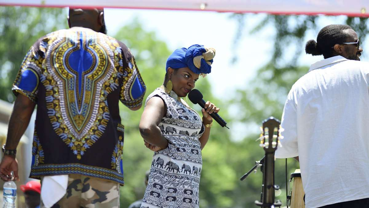 Iyona Laurrel, of Springfield, performs during the Juneteenth Festival on Germantown Avenue.