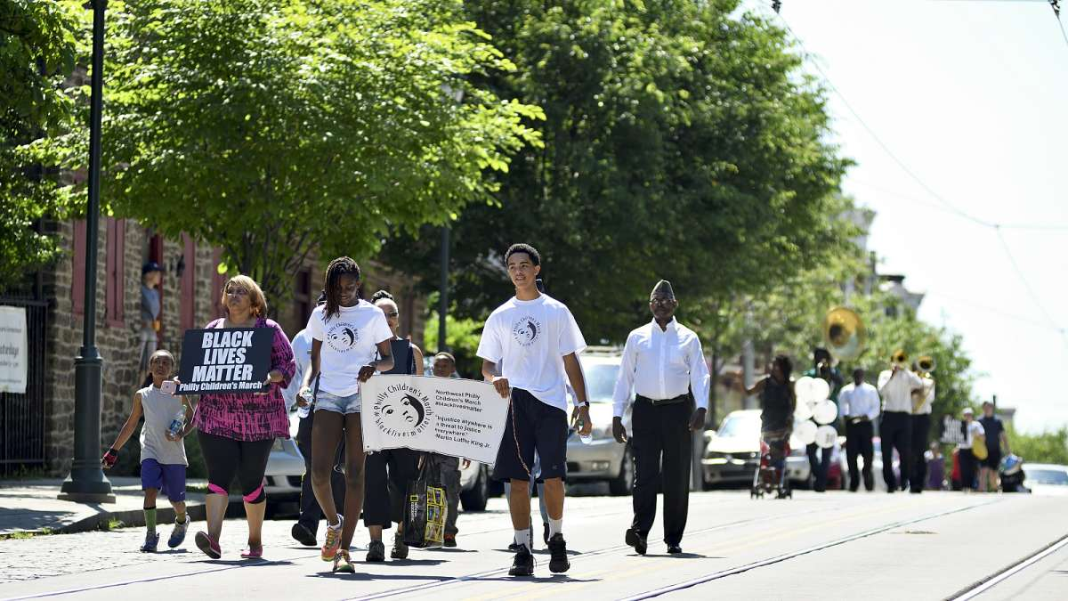The Philly Children's March leads the Freedom Parade past Grumblethorpe on Germantown Avenue as they walk from the historic marker to the Juneteenth Festival near Johnson House Historic Site.