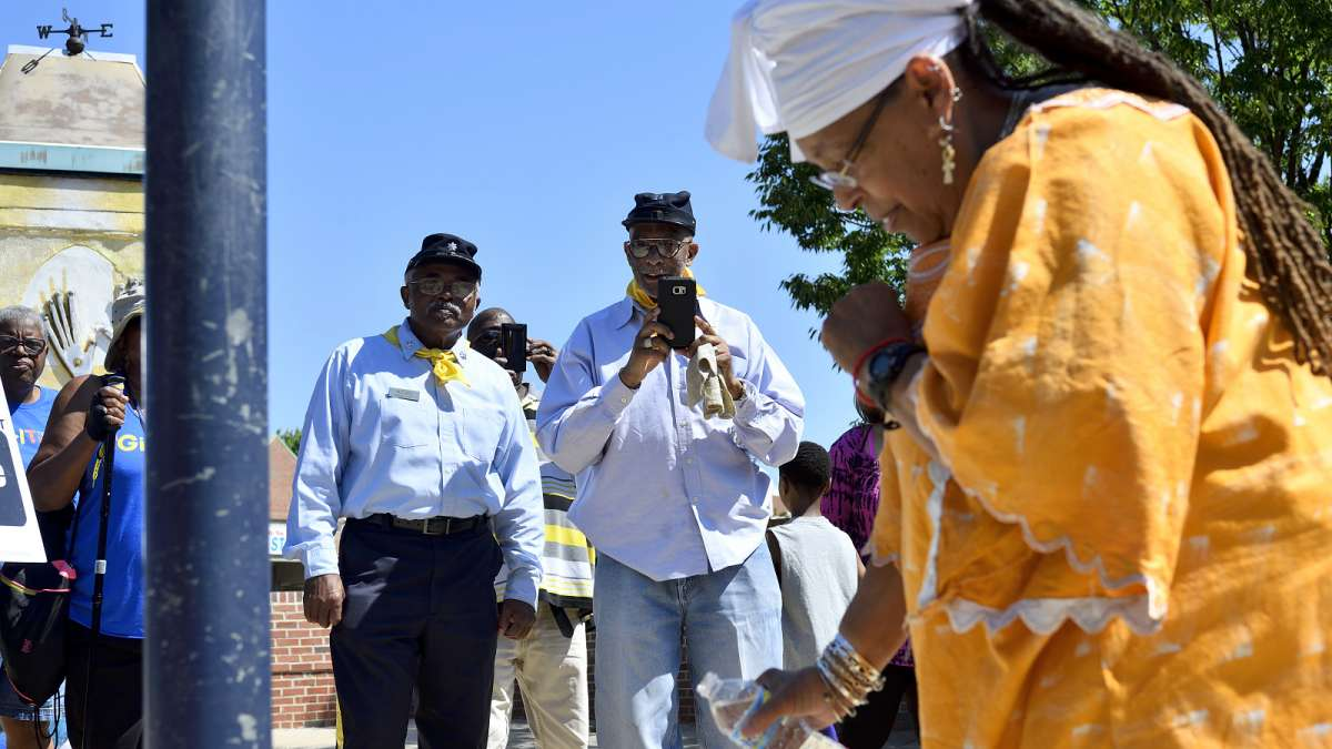 ''Cornel'' John McCall and ''Captain'' Hassan Ali Hameen, representing the ''Resurrected Order'' of Buffalo Soldiers Philadelphia Chapter, watch the pouring of libation at the historic marker.