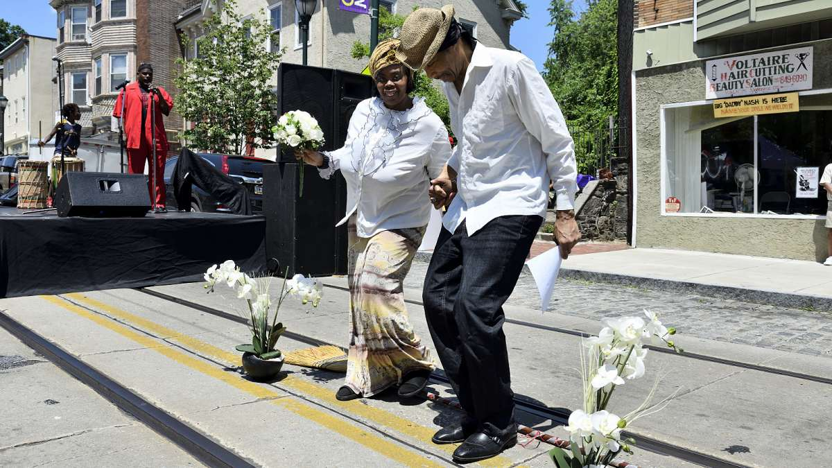Couples jump the broom during the Juneteenth Festival on Germantown Avenue. The jumping of brooms is an African-American tradition that was part of wedding ceremonies of slaves in the South.