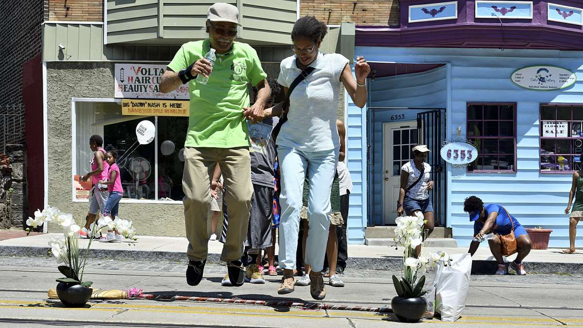 Couples jump the broom during the Juneteenth Festival on Germantown Avenue. The jumping of brooms is African-American tradition that was part of wedding ceremonies of slaves in the South.