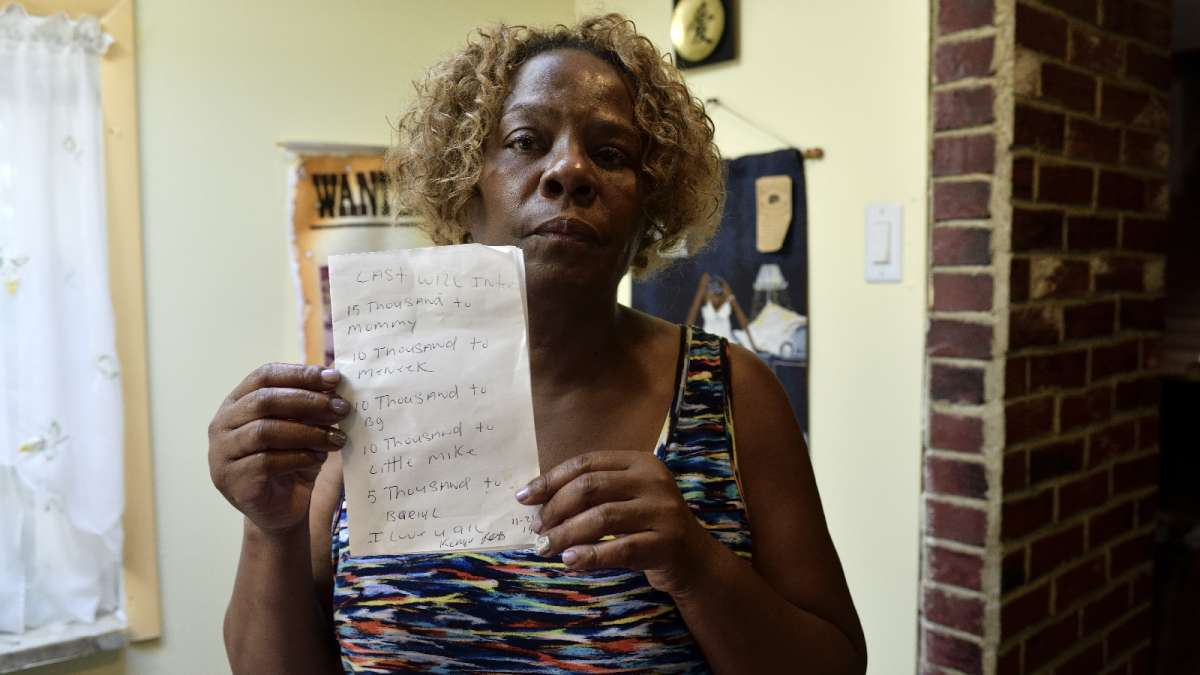 Michell Witherspoon shows a handwritten will made by her son, Kenyada Jones, in 2014.  Jones died at Curran-Fromhold Correctional Facility on July 2. (Bastiaan Slabbers for NewsWorks)