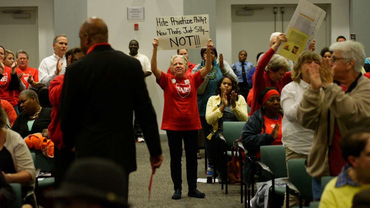 Supporters stand up as PFT President Jerry Jordan walks back to his seat.