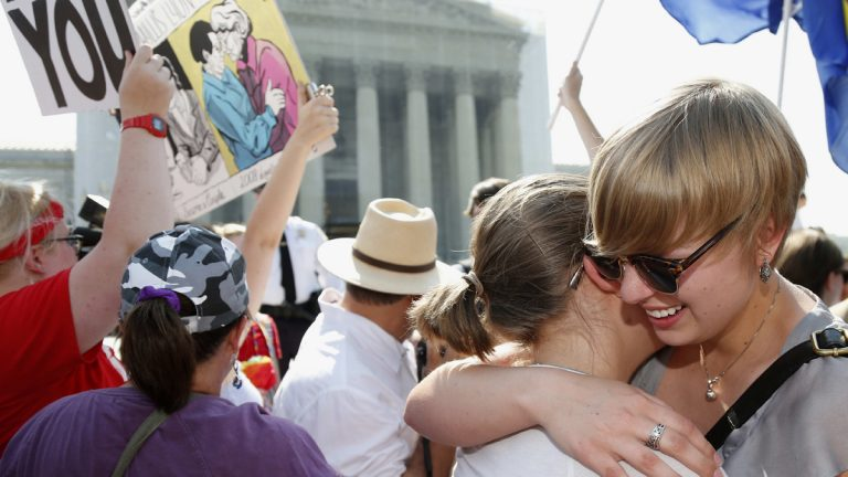 American University students Sharon Burk, left, and Molly Wagner, embrace outside the Supreme Court after Wednesday DOMA ruling.  (AP Photo/Charles Dharapak)