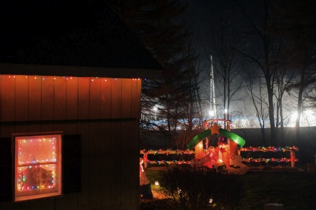 <p><p>Bright lights illuminating a Halliburton fracking site next to the leaseholders' home, which is decorated with Christmas lights, in Franklin Forks, Susquehanna County, Pa. (Nina Berman/Marcellus Shale Documentary Project)</p></p>