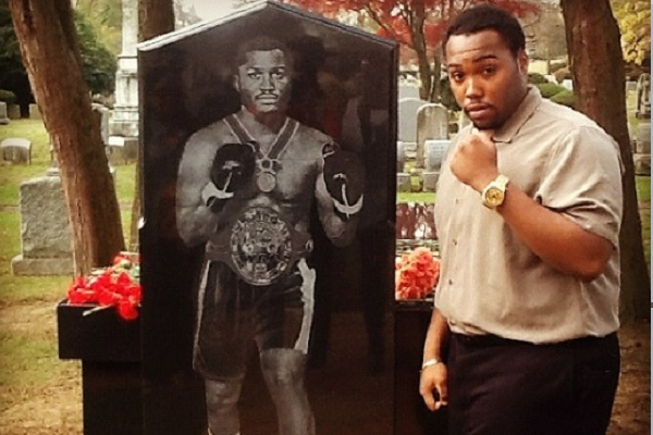<p><p>Frazier's youngest son Derek poses next to a likeness of the boxing legend who died of liver cancer in Nov. 2011. (Courtesy of Derek Frazier)</p></p>
