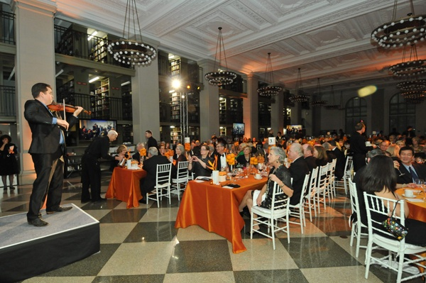 <p><p>Violinist Wallace DePue entertains guests during dinner in Philbrick Hall (Photo courtesy of Kelly & Massa Photography)</p></p>