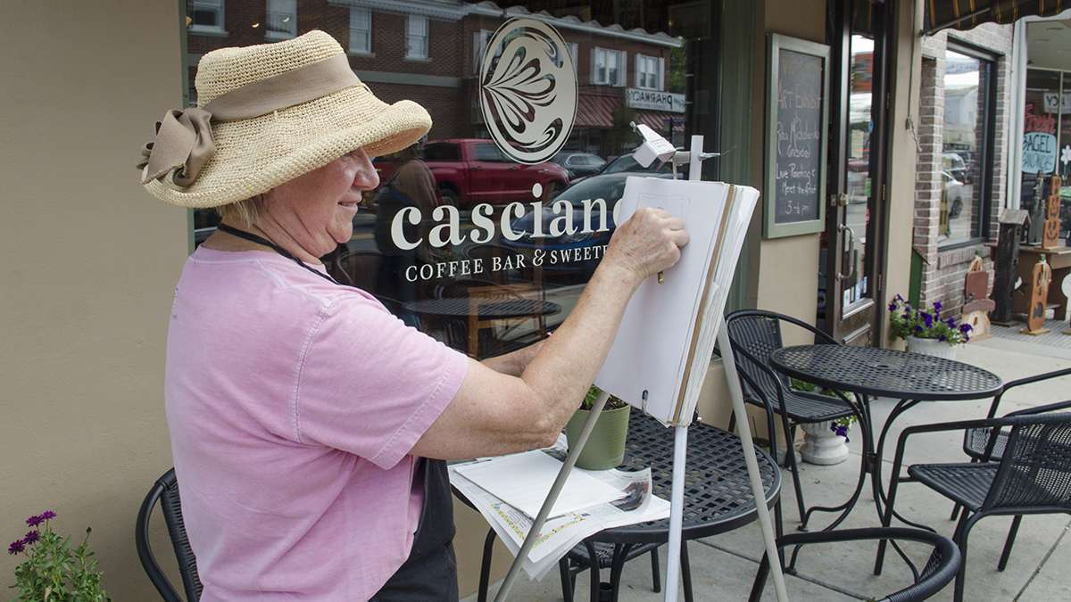 Artist Rita Michalenko paints a street scene during the first annual New Jersey Fringe Festival in Hammonton.