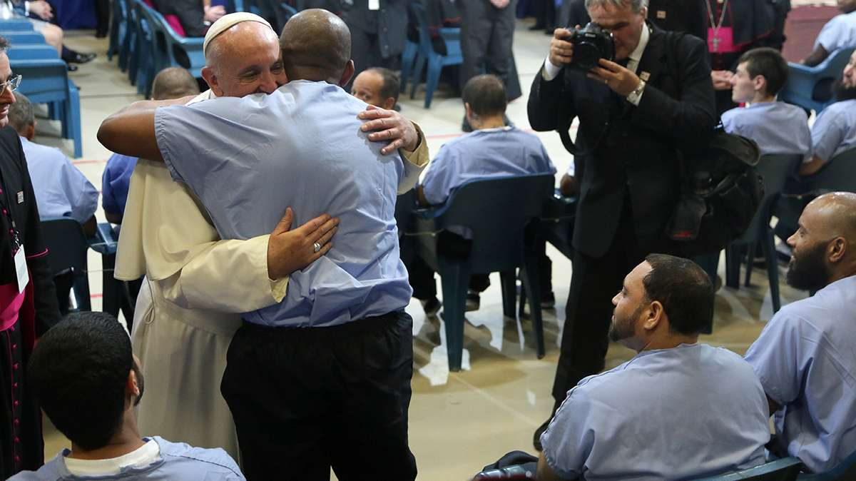 Two inmates jumped up to hug the pontiff. (Kevin Cook/for NewsWorks)