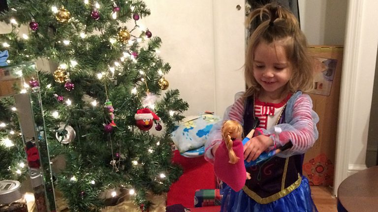 Ella Janos,2, wearing a costume and holding a doll from the Disney movie 'Frozen' (Image courtesy of Joseph Janos)
