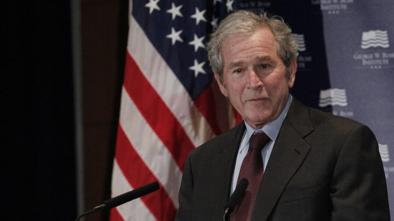 Former President George W. Bush gives opening remarks at the Federal Reserve Bank of Dallas for a conference titled