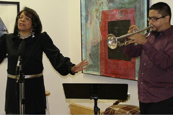 "<p><p>Terri ""Nightowl"" Lyons performs poetry as Victor Puentes plays trumpet during a rehearsal for a new public access television series. (Trenae V. McDuffie/for NewsWorks)</p></p>"