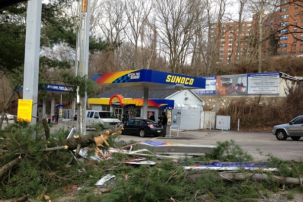 <p><p>Heavy winds knocked a tree down, and through the price sign, at the Sunoco gas station at Wissahickon Ave. and Rittenhouse St. on Thursday morning. (Jane Winters/for NewsWorks)</p></p>