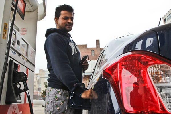 <p>Ronak Vora feels the pain at the pump but said that he doesn't drive much. (Kimberly Paynter/WHYY)</p>