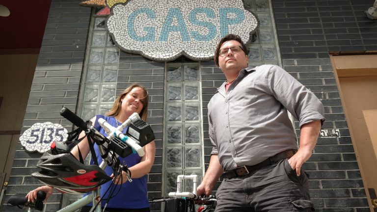The Group Against Smog and Pollution's (GASP) Jessica Tedrow and Jamin Bogi get ready to take their bike-mounted air quality monitors for a spin. The group is using cyclists to help track air pollution hot spots in Pittsburgh. (Lou Blouin/for The Allegheny Front)