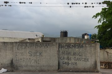 Street graffiti with an anti-gay message covers part of a privacy wall in a neighborhood in Jamaica. Advocates say much of the homophobia is fueled by a nearly 150-year-old anti-sodomy law that bans anal sex as well as by dancehall reggae performers who flaunt anti-gay themes. (AP Photo/David McFadden)