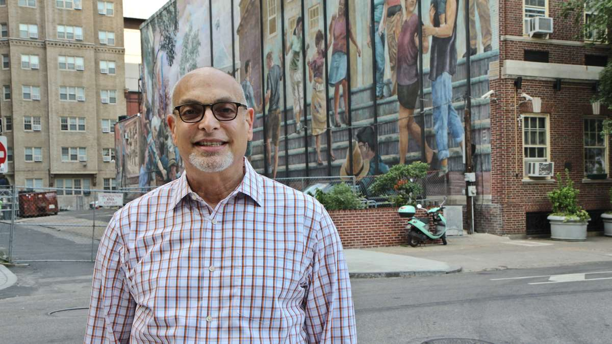 Heshie Zinman is shown in 2013 in front of the William Way LGBT Community Center at Spruce and Juniper streets in Philadelphia. (Kimberly Paynter/WHYY, file)