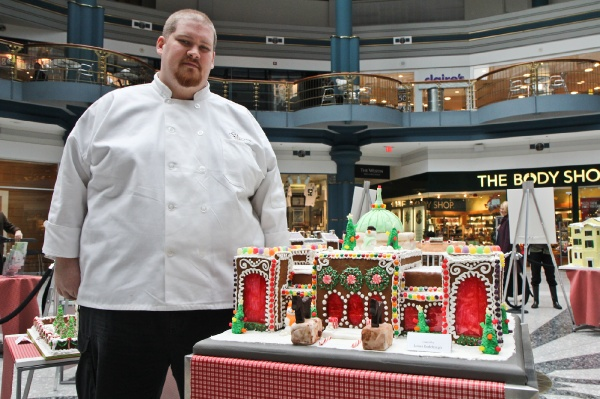 <p>James Rodenbaugh of Br?l?e Catering next to his gingerbread creation of the Please Touch Museum. (Kimberly Paynter/for NewsWorks)</p>