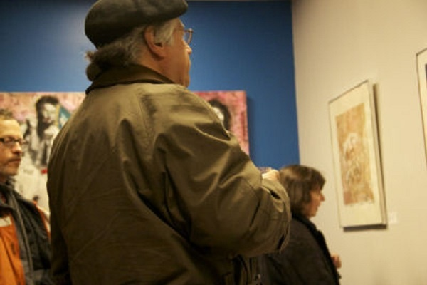 <p><p>Jim Dragoni observed art at the On The Ground exhibit. (Haley Kmetz/for NewsWorks)</p></p>